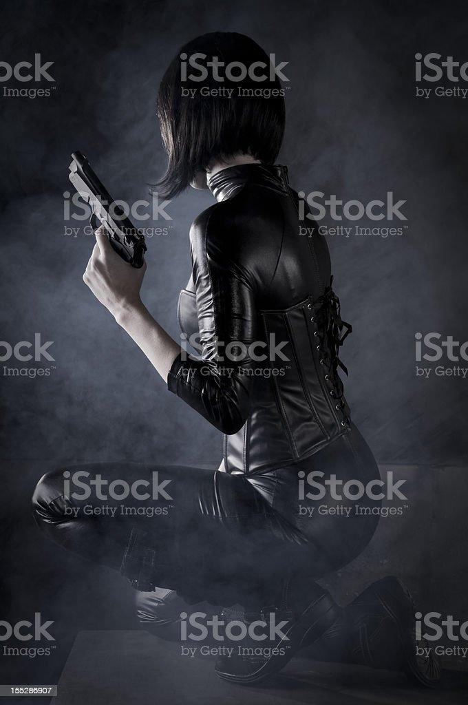 Female Assassin with gun stock photo