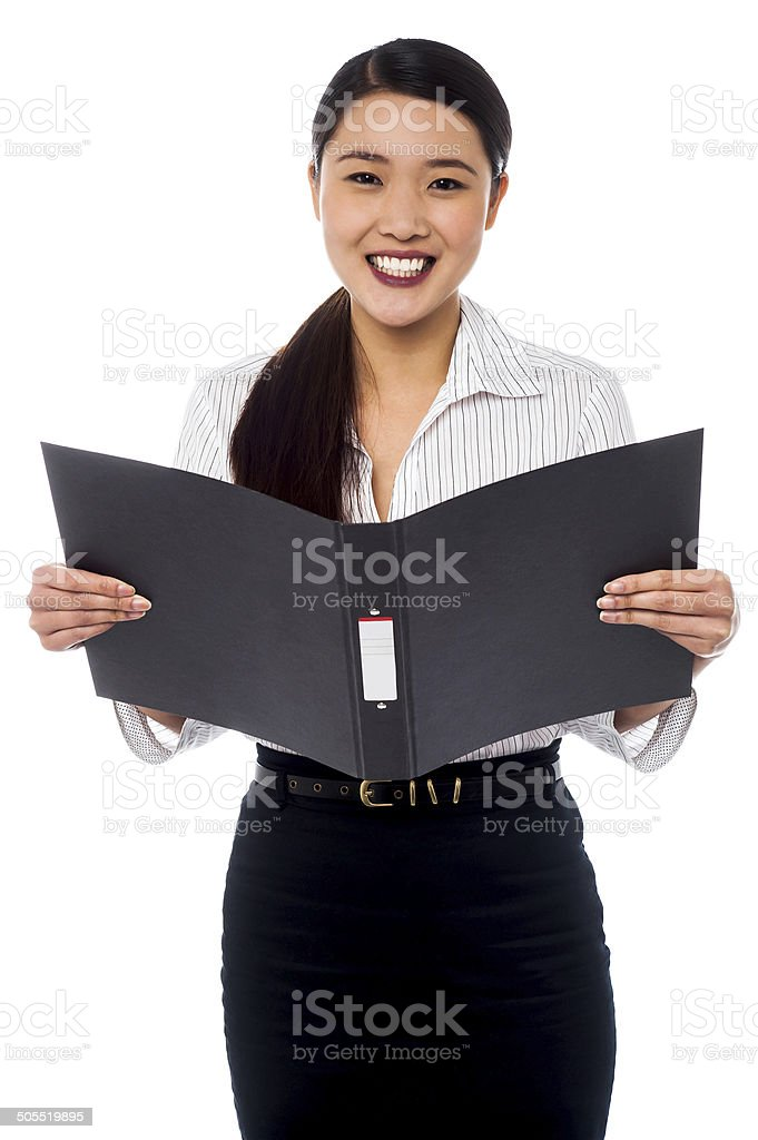 Female assistant reviewing file royalty-free stock photo