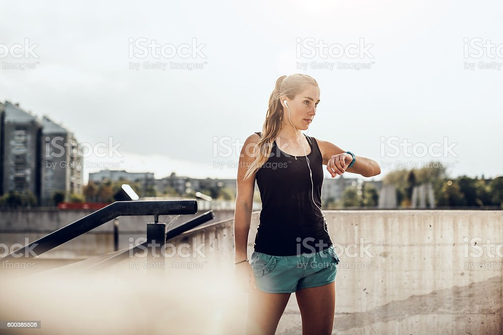 Female Athlete Checking Her Heart Rate on a Fitness Tracker stock photo