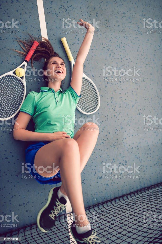 Female Athlete Enjoying The Freedom Of Tennis