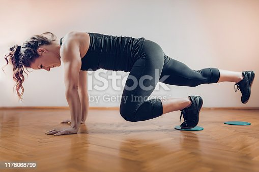 Female Athlete Exercising with Sliding Discs.