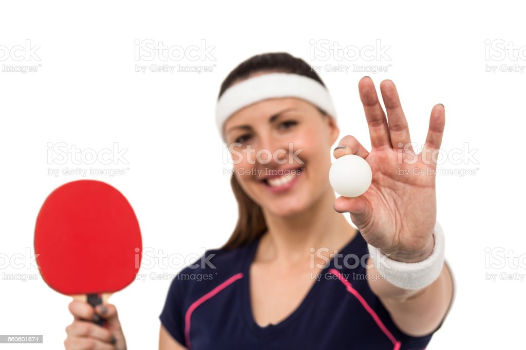 Female athlete holding table tennis paddle and ball royalty-free stock photo