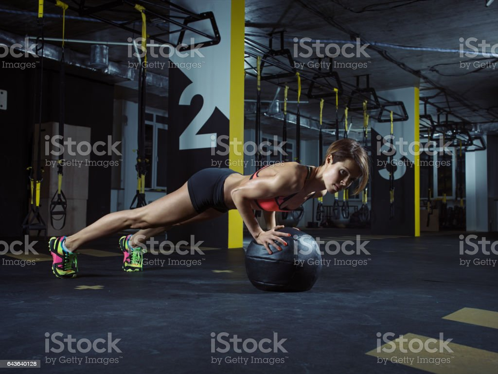 GYM TRAINING: Female athlete in action stock photo