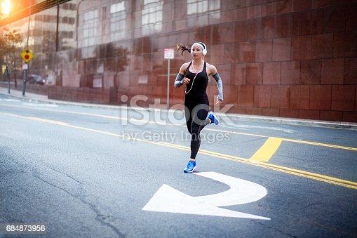 istock Female athlete in the city 684873956