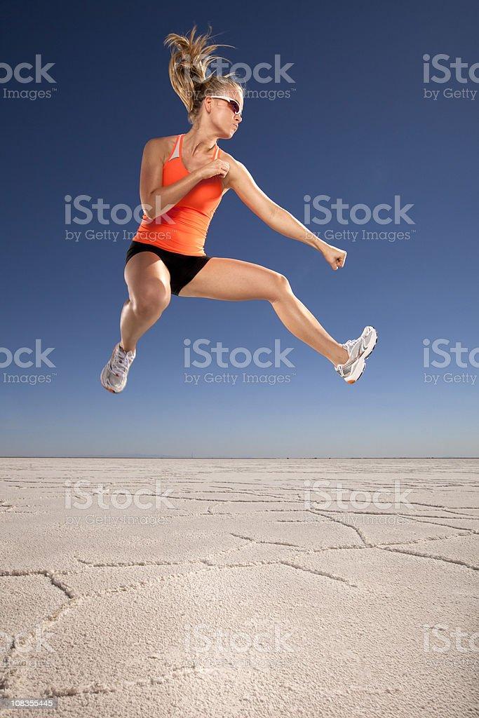 Female Athlete Jumping stock photo