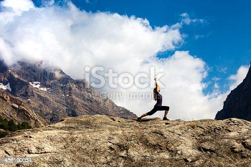 istock Female athlete makes yoga asana 486100034