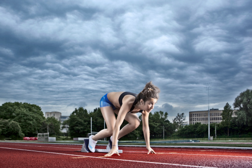 Female Athlete On A Starting Block Stock Photo - Download Image Now