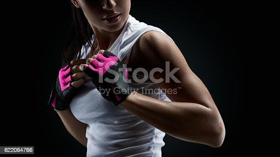 618330244istockphoto Female athlete on black background 622064766