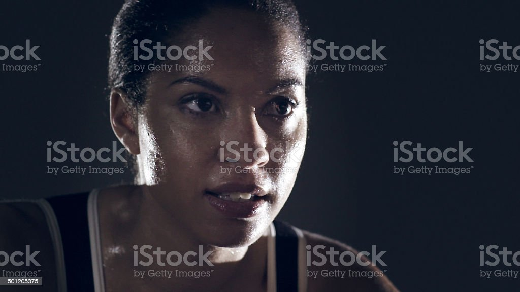 Female athlete portrait against black stock photo