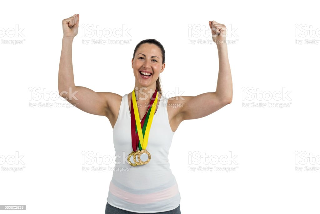 Female athlete posing with gold medal after victory royalty-free stock photo