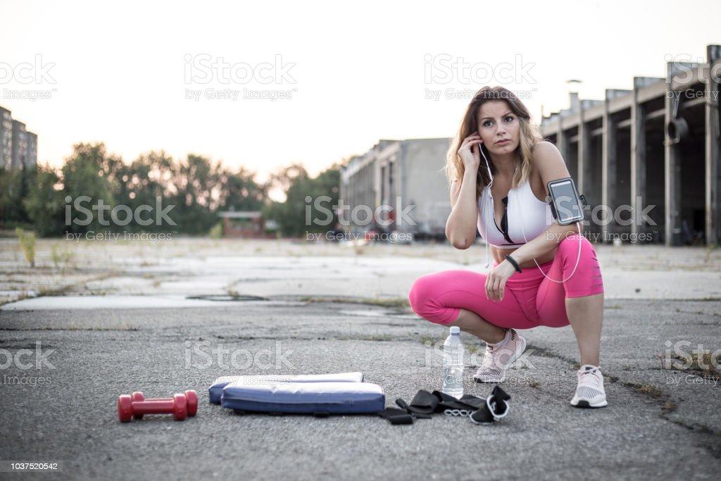 Female athlete preparing for running stock photo