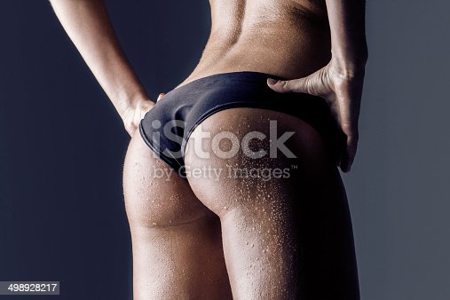 istock female athlete rear view, trained buttocks 498928217