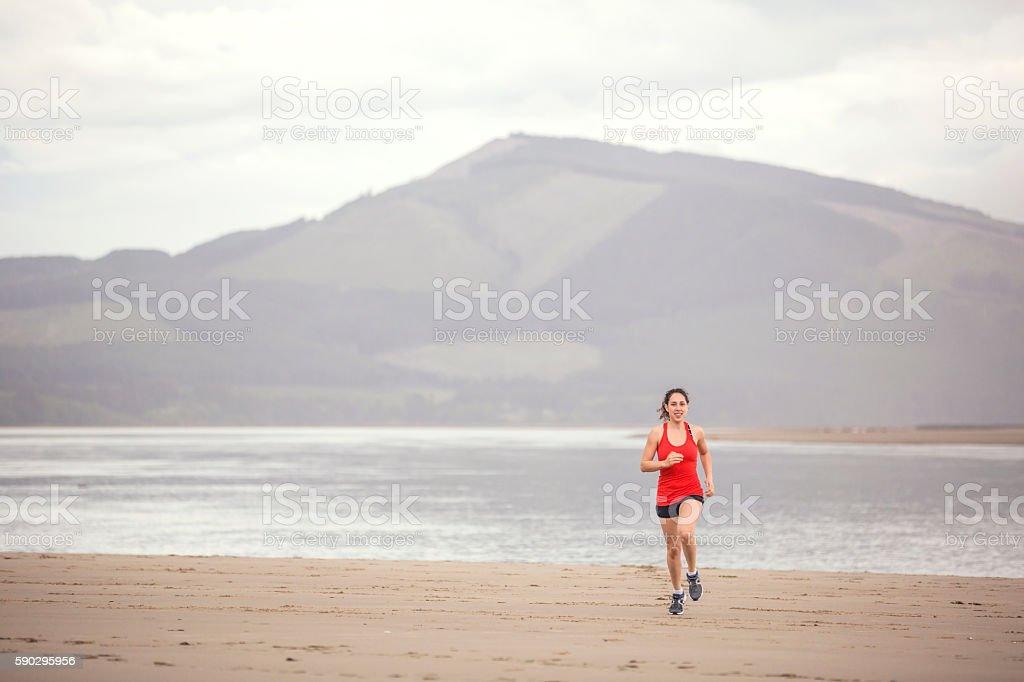Female athlete running on sand royaltyfri bildbanksbilder