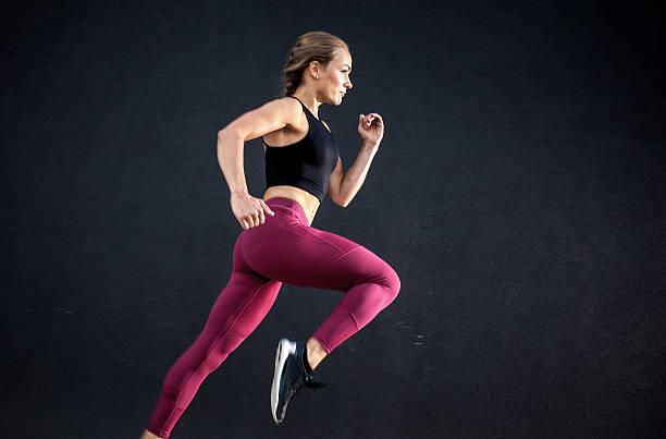 Female Athlete Running Outdoors stock photo