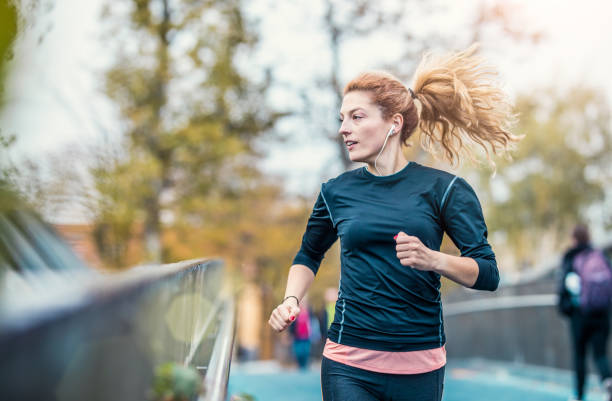 Female Athlete Running Outdoors stock photo