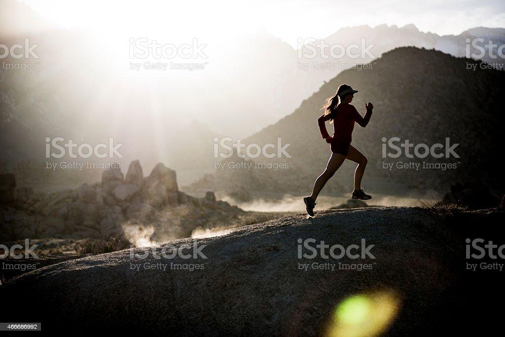 female athlete running stock photo