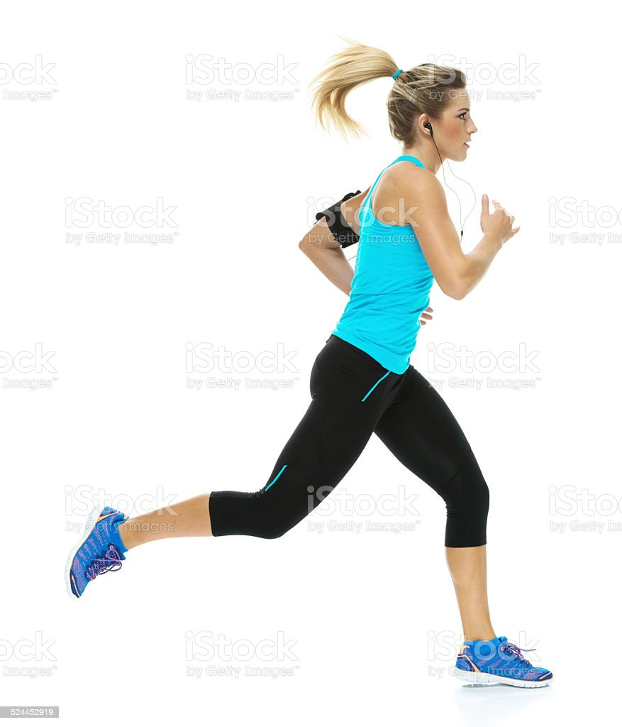 Female athlete running stock photo