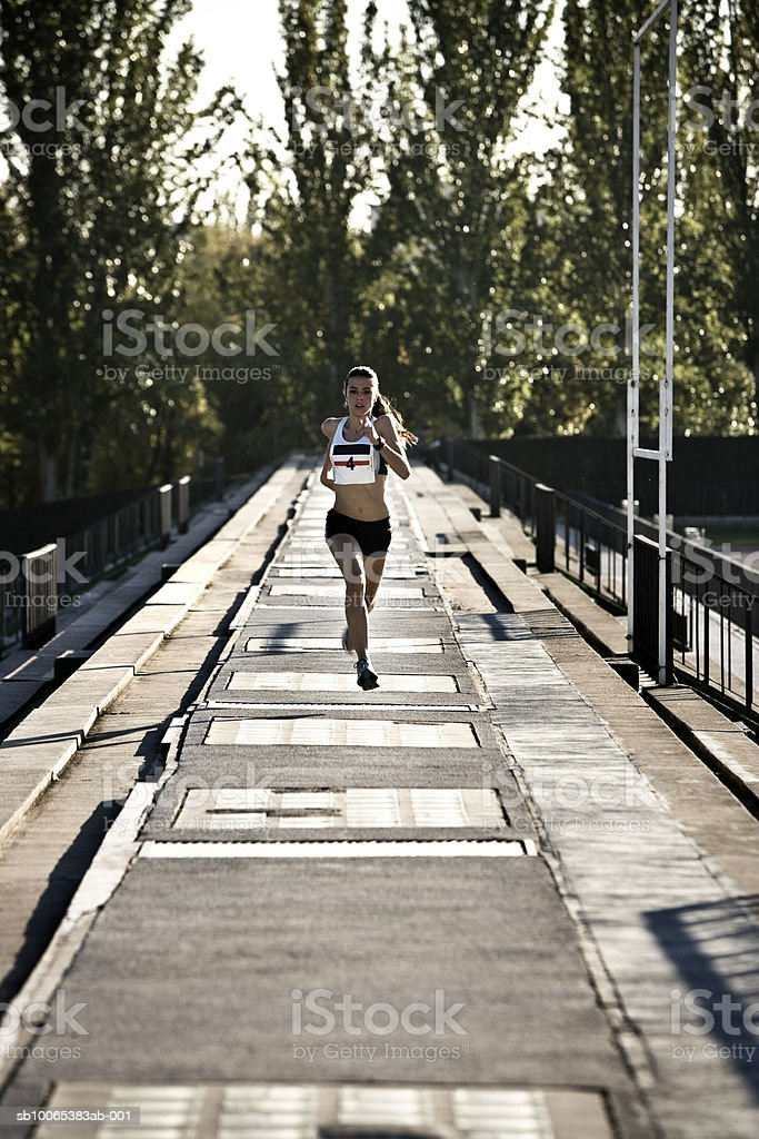 Female athlete running photo libre de droits