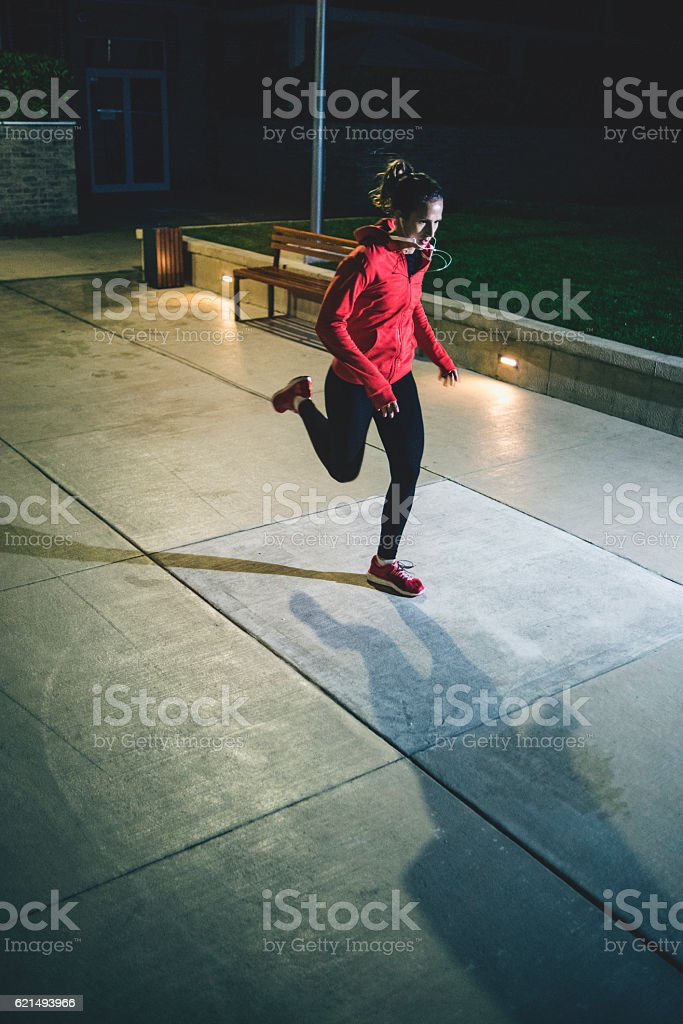Female athlete running through the night foto stock royalty-free