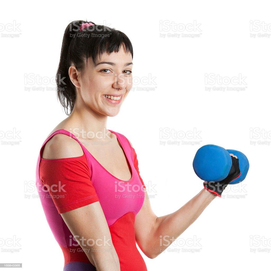Female athlete smile while holding weights stock photo