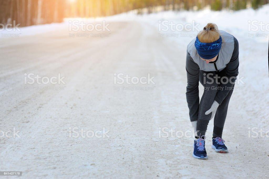 Female athlete sport injury. stock photo