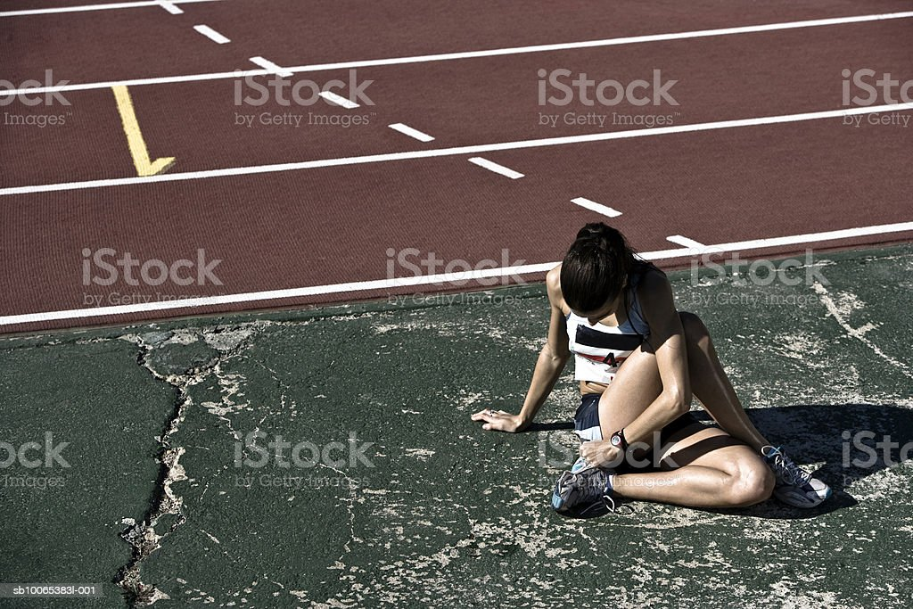 Female athlete stretching in stadium royalty-free stock photo