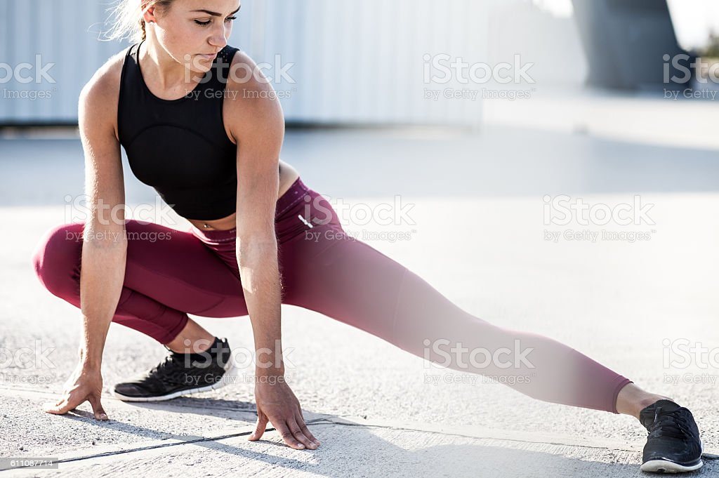 Female Athlete Stretching Outdoors stock photo