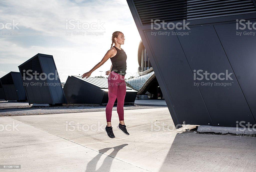 Female Athlete Stretching Outdoors stock photo