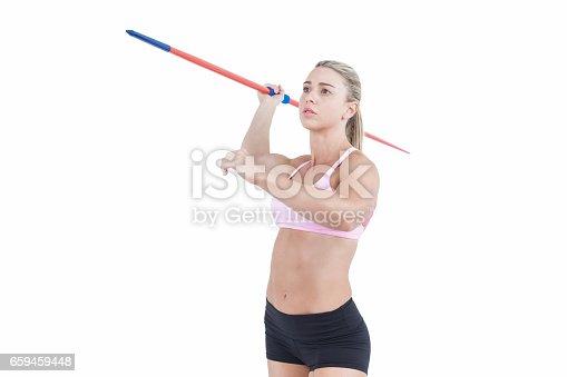 856713554istockphoto Female athlete throwing a javelin 659459448
