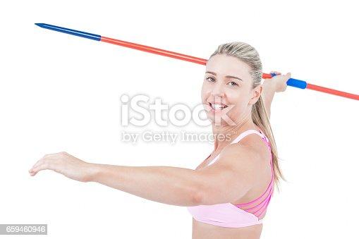 856713554istockphoto Female athlete throwing a javelin 659460946