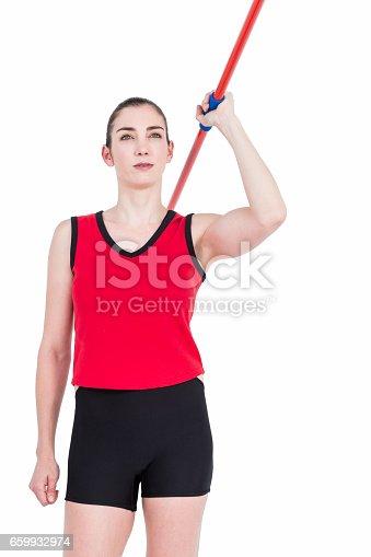 856713554istockphoto Female athlete throwing a javelin 659932974