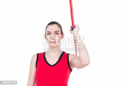 856713554istockphoto Female athlete throwing a javelin 659933728