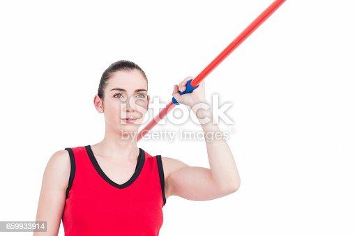 856713554istockphoto Female athlete throwing a javelin 659933914
