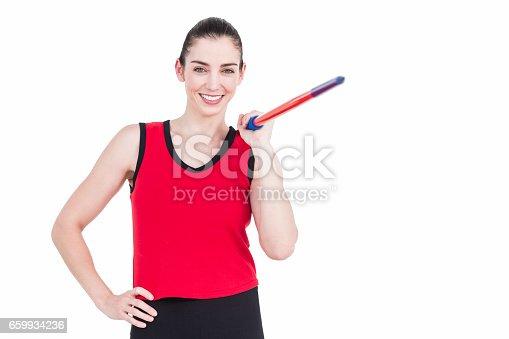 856713554istockphoto Female athlete throwing a javelin 659934236