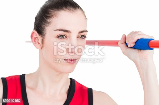 856713554istockphoto Female athlete throwing a javelin 659940450