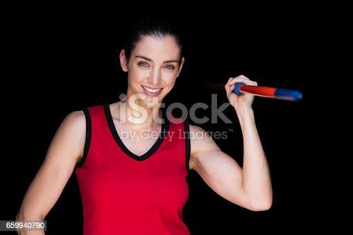 856713554istockphoto Female athlete throwing a javelin 659940790