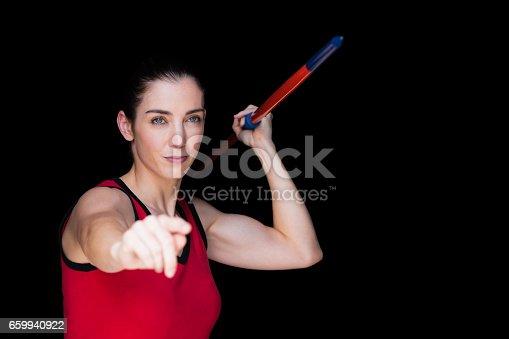 856713554istockphoto Female athlete throwing a javelin 659940922