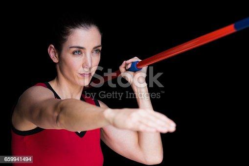 856713554istockphoto Female athlete throwing a javelin 659941494