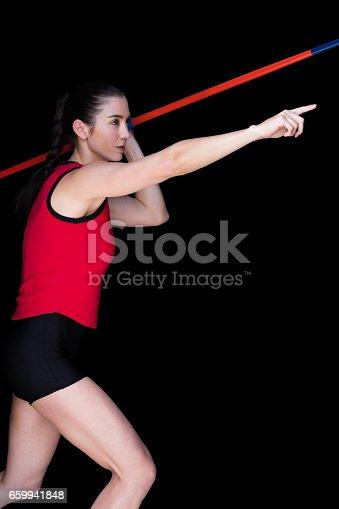856713554istockphoto Female athlete throwing a javelin 659941848