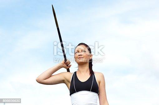 856713554istockphoto Female athlete throwing the javelin 856656630