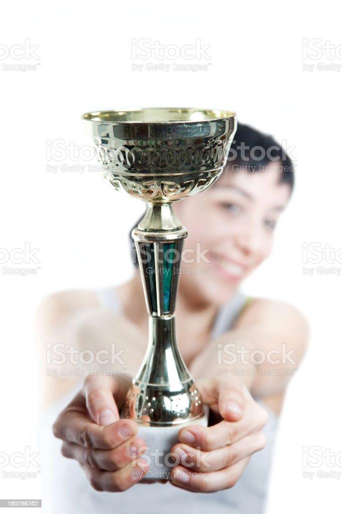 Female athlete wins a Trophy. Success concept stock photo