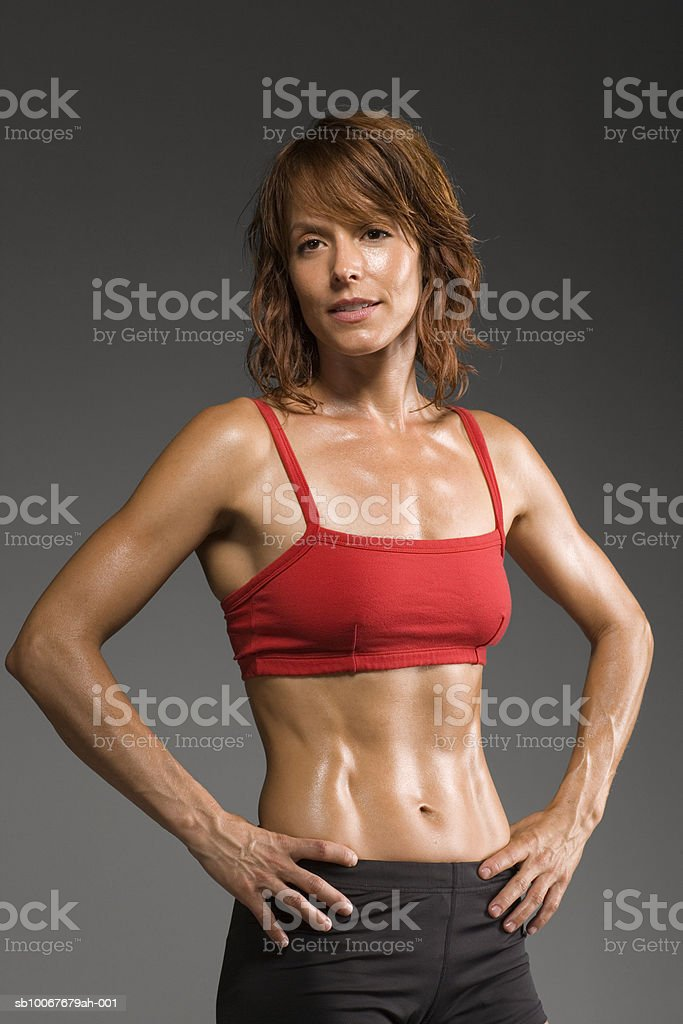 Female athlete with hands on hips, portrait 免版稅 stock photo