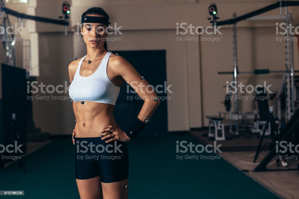 Female athlete with motion capture sensor stock photo
