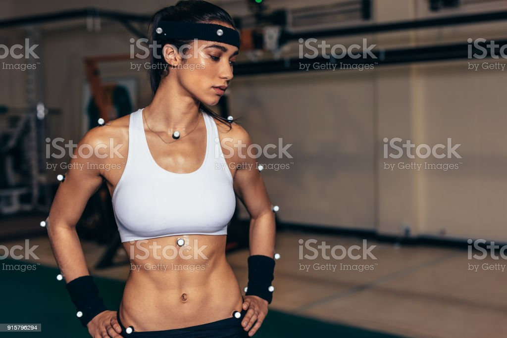 Female athlete with motion capture sensors in biomechanics lab stock photo