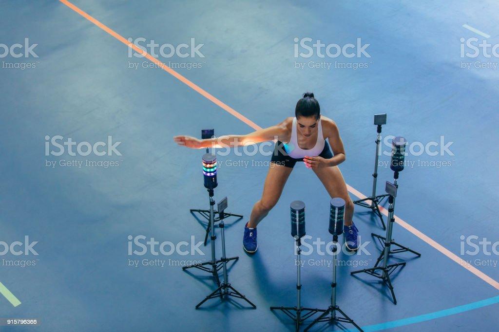 Female athlete with visual stimulus system at gym stock photo