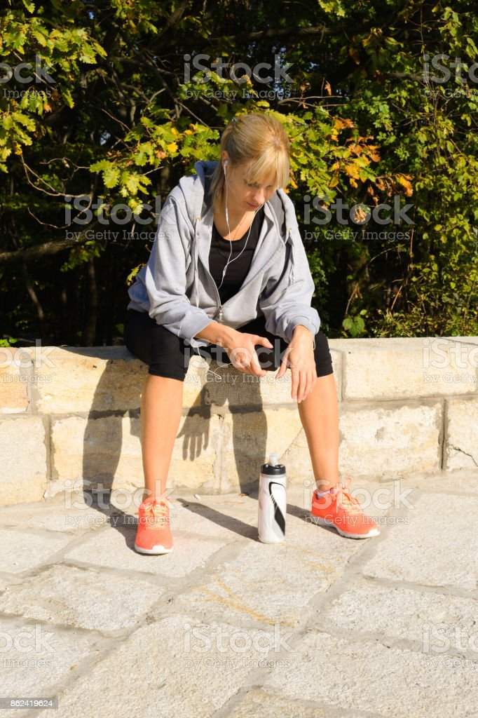 Female athlete working out outdoors stock photo