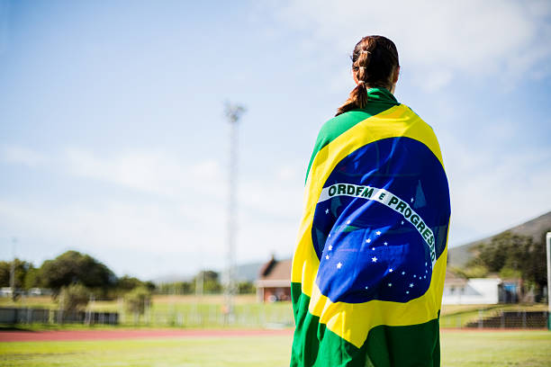 female athlete wrapped in brazilian flag - brasilien flagga bildbanksfoton och bilder