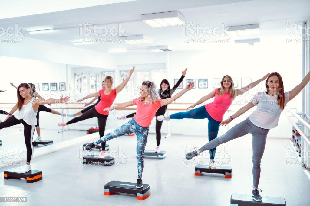 Female Athletes Practicing Zumba In Gym Female Athletes Practicing Zumba In Gym Adult Stock Photo