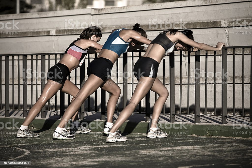 Female athletes stretching in stadium royalty-free 스톡 사진