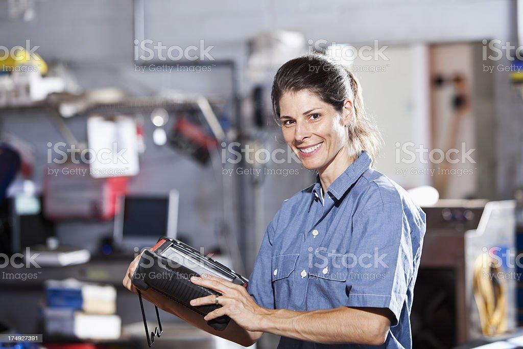 Female auto mechanic stock photo